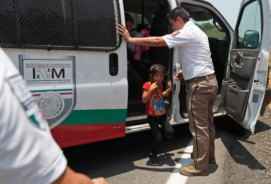 A Central American migrant child cries as she is asked to get into an immigration vehicle as she is detained on the highway to Pijijiapan, Mexico, Monday, April 22, 2019. Mexican police and immigration agents detained hundreds of Central American migrants on Monday, the largest single raid on a migrant caravan since the groups started moving through Mexico last year.