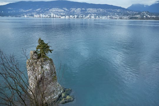 Siwash Rock, as seen from Vancouver's Stanley Park, is among the city's often-photographed natural attractions.