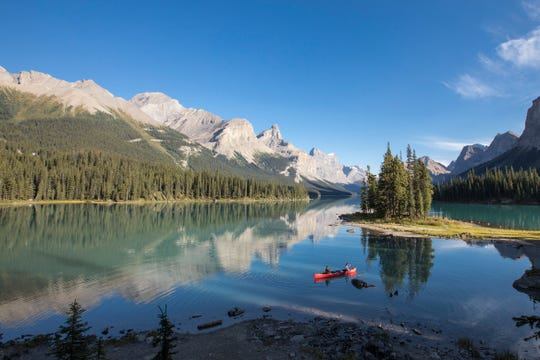 Immerse yourself in Jasper National Park by taking a nature walk, or canoe on Maligne Lake.