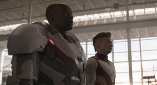 With a three-hour run time, we advise against wearing complicated outfits to the theater like Hawkeye (Jeremy Renner, right). Definitely not like War Machine (Don Cheadle, left).