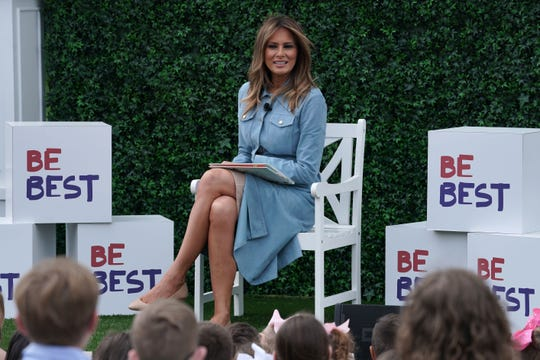 First lady Melania Trump reads a story to children during the 141st Easter Egg Roll on the South Lawn of the White House April 22, 2019.