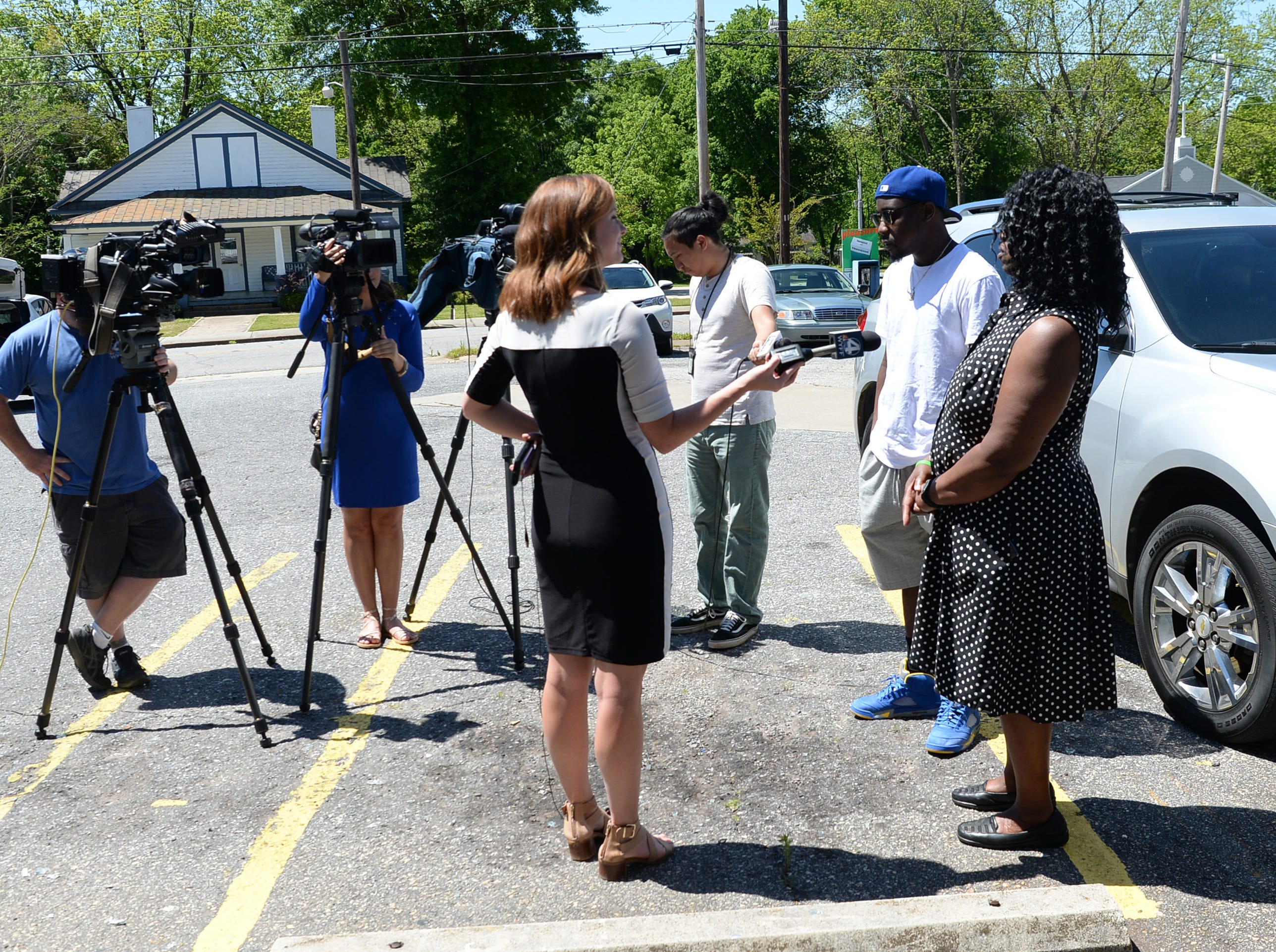 Gloria Smith, left, talks with media after a press conference asking the public for tips in the cold case homicide case. Randy Smith was shot in a drive-by shooting in March 2016.