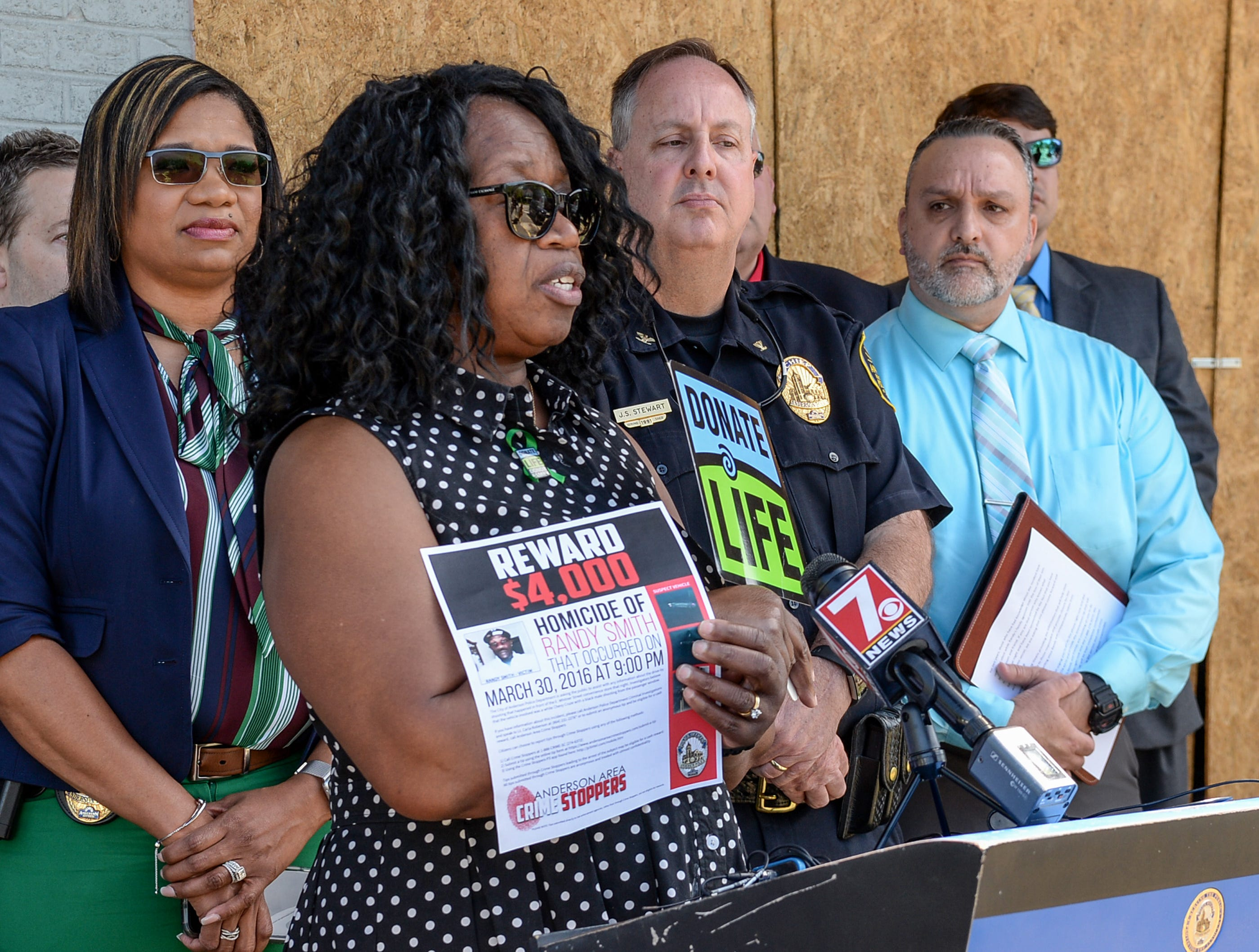 Anderson police Lt. Carla Roberson, left, listens to Gloria Smith speak at a press conference concerning the cold case homicide of Randy Smith on East Whitner Street in Anderson Tuesday. Anderson Area Crime Stoppers held the press conference at the site where her son Randy Smith died, asking for the public to come forward with any tips.