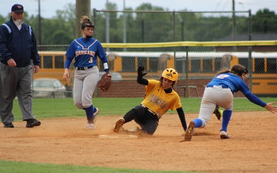 Outfielder Katie Spires slides safely into second base against Wren.