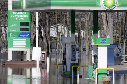 Flood water stops customers from filling up Tuesday at the Riverside Pump-N-Munch, formerly Colwitz's Convenience Store, on State 54 in Shiocton.