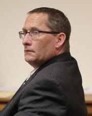 Jason LaVigne sits at the defense table during the first day of his trial Tuesday in Outagamie County. LaVigne is a former Little Chute High School teacher accused of sexually assaulting a 14-year-old student nearly two decades ago.