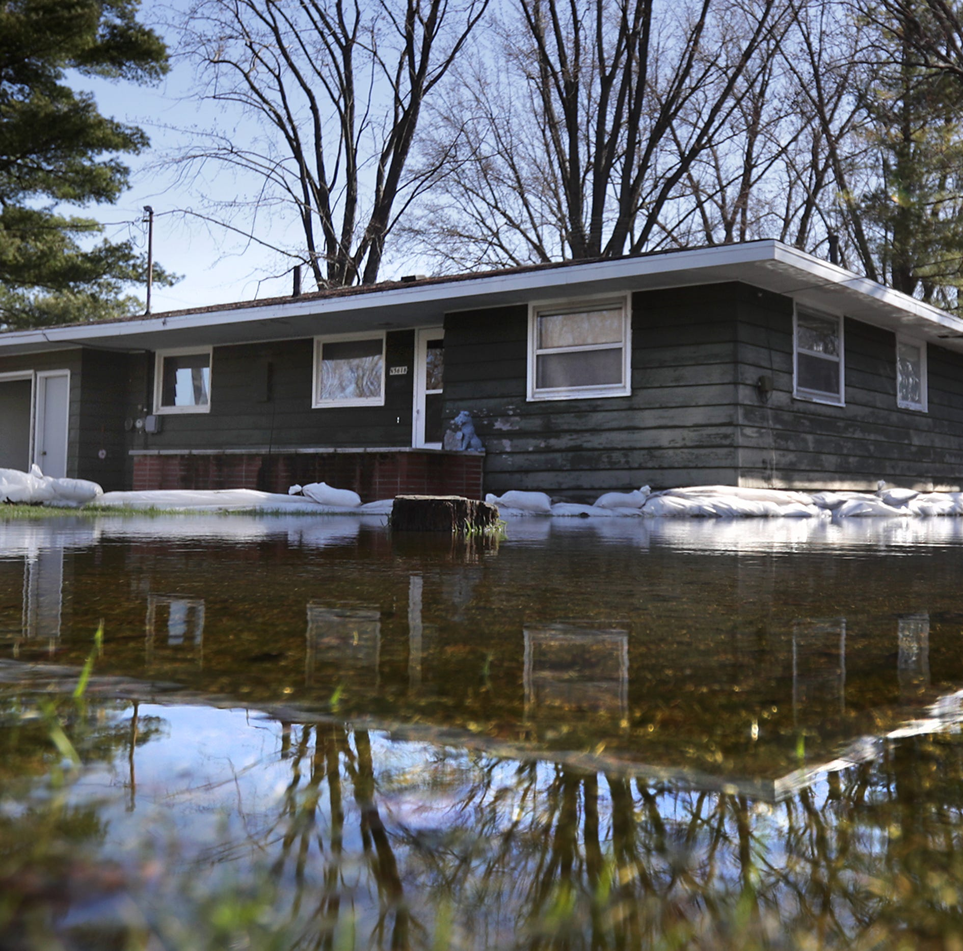 Waterlogged: Shiocton copes with flooding as the Wolf River exceeds 13 feet