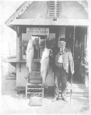 Seger's branch store on Asbury Park Fishing Pier, circa 1910. Tom Brunineger, with two striped bass.