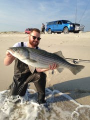 Kevin Newberg, Spring Lake, with a 35-pound striped bass he caught from Island Beach State Park.
