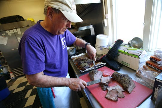 Warren Schueler, a retired culinary institute instructor, prepares a roast beef for lunch at St. Mark's soup kitchen at St. Mark's Episcopal Church in Keansburg, NJ Tuesday, April 23, 2019.