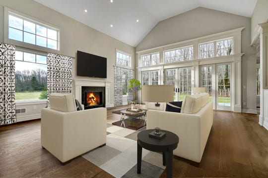 The family room features a set of French Doors and custom windows.