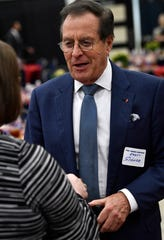 "Horst Schulze, the former president of Ritz-Carlton, greets an attendee at the luncheon after the First Financial Bankshares annual meeting Tuesday. Schulze has authored a book on customer service, ""Excellence Wins,"" which was provided free to guests."