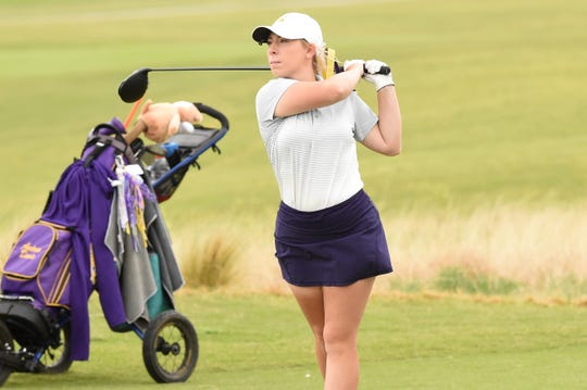 Wylie's Andrea Davis follows her shot during the second round of the Region I-5A tournament at The Rawls Course in Lubbock on Tuesday, April 23, 2019. Davis shot a 177 to tie for 47th.