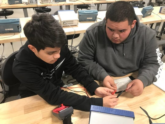 Zachary Galbreath, left, and Devine de los Santos, both seniors at Abilene High School, test resistance during an electrical power and controls class at Texas State Technical College on Feb. 20. The two are part of the joint program between Abilene ISD and the Abilene Industrial Foundation called NextUniversity, which offers scholarships and college-level trades education to high school students.