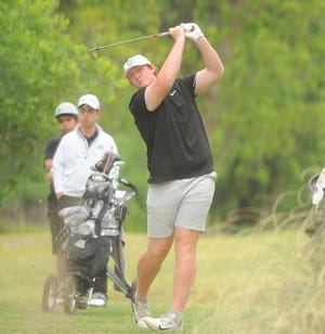 Comanche junior Kasey Middleton watches a drive during the second round of the Region I-3A golf tournament on Tuesday at Shady Oaks Golf Course in Baird.