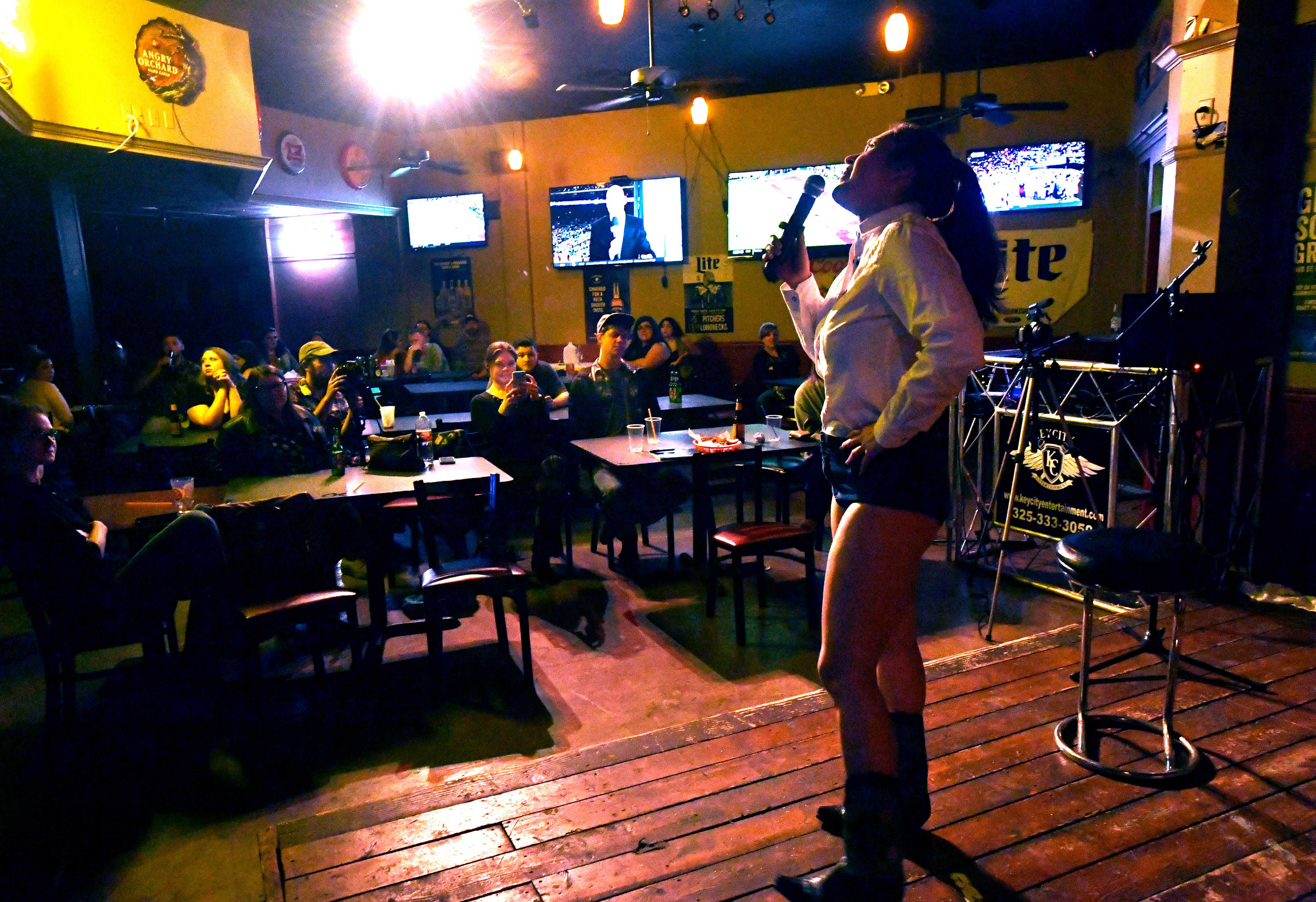 Leilani Carrasco gives a stand-up comedy routine about her attire during Open Mic Comedy Night at The Zone Bar & Grill.