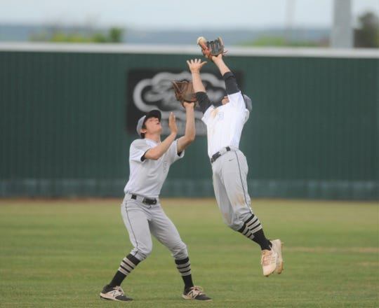 Clyde shortstop Ethan Hawk (3) leaps for a catch in front of left fielder Hunter Lopez in a District 5-3A baseball game against Jim Ned on Monday, April 22, 2019, in Tuscola.