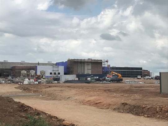 Crews continue building the Wylie East Junior High School on Colony Hill Road on Tuesday. District trustees will consider approving a football field and track complex, as well as tennis courts, at the school during a special meeting at 8 a.m. Friday.