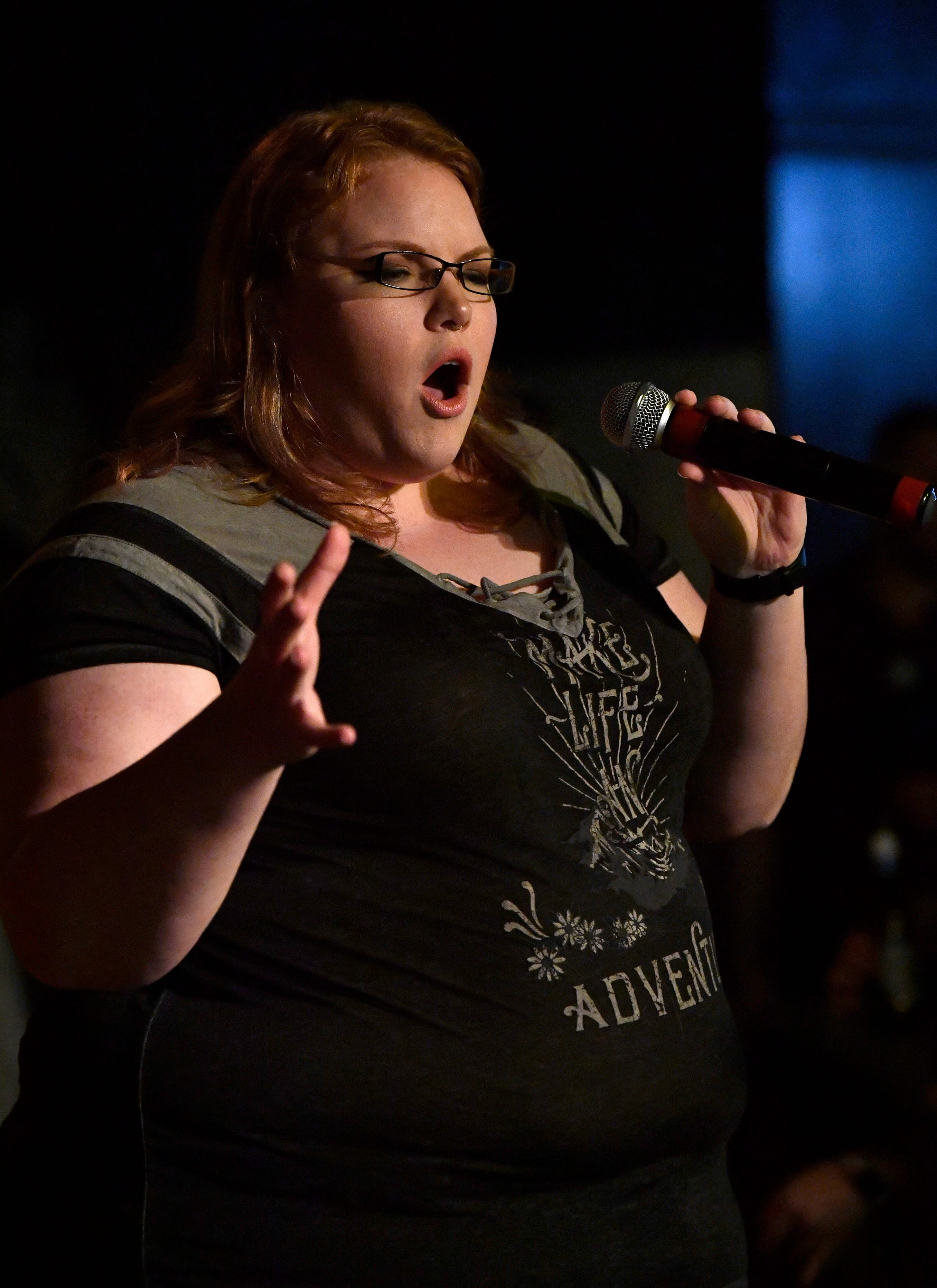 Anna Gabriel performs at The Zone Bar & Grill during Open Mic Comedy Night.