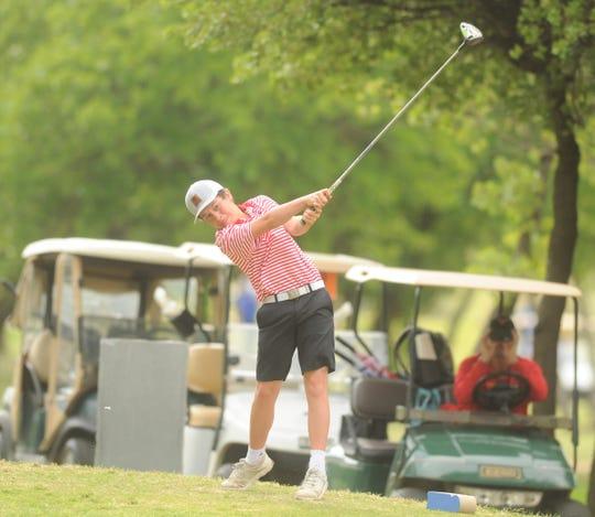 Eastland freshman Blane Brooks follows through on a drive at the Region I-3A golf tournament Tuesday at Shady Oaks Golf Course in Baird.
