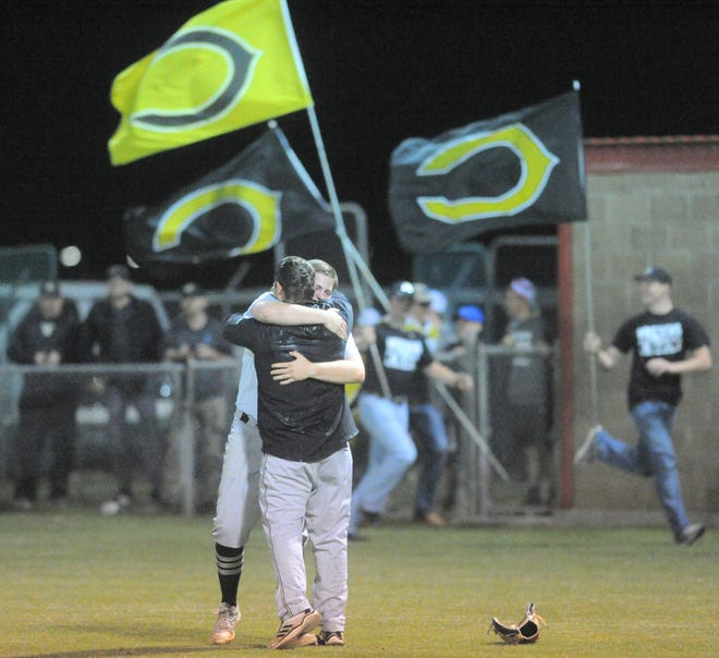 Clyde baseball coach Colby Rowley and pitcher Riley Rice hug after the Bulldogs clinched their fourth consecutive district championship with a 5-3 win over Jim Ned on Monday.