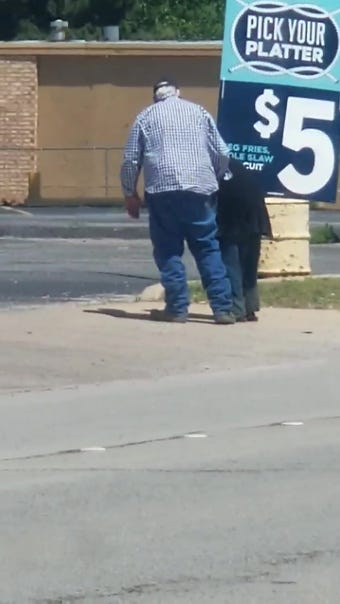 J.R. Brown of Abilene, Texas, stopped traffic to help an elderly woman cross a busy five-lane street. She wanted to get some chicken, she told him.
