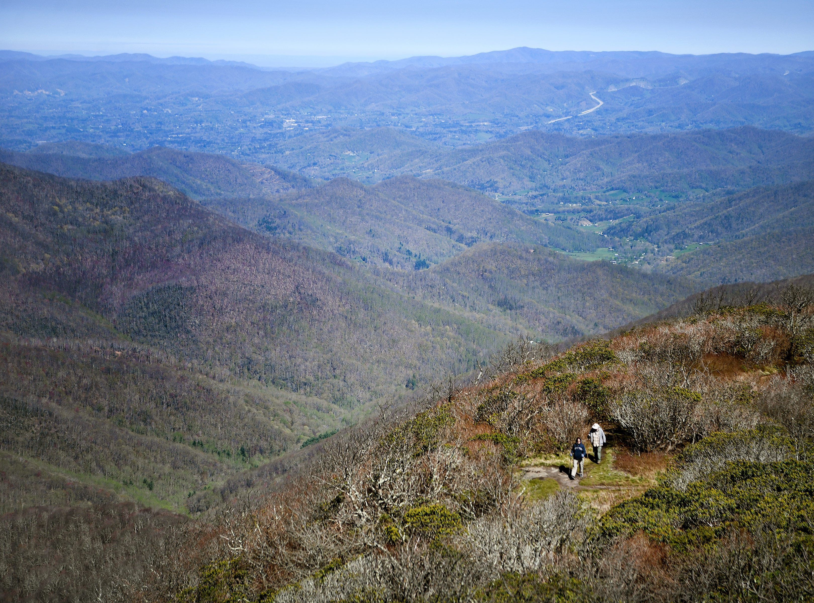 Claire and Dave Davis, of West Virginia, make their way to the top of the Craggy Pinnacle on the Blue Ridge Parkway on April 22, 2019.