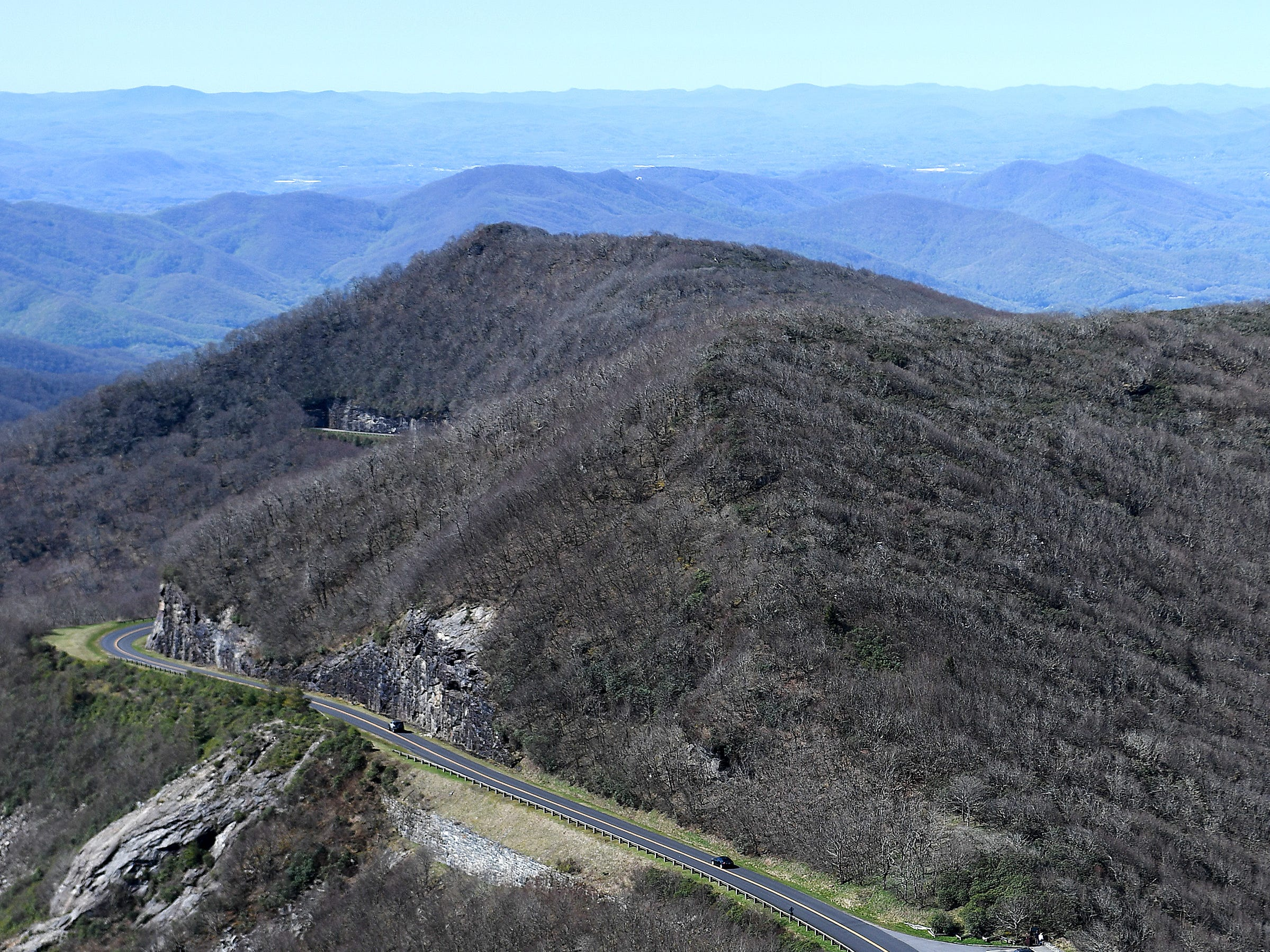 A view from the top of the Craggy Pinnacle trail on the Blue Ridge Parkway on April 22, 2019. Visitors are legally not allowed to cross the stone walls of the platform for safety and the survival of the fragile plants that grow beyond them.