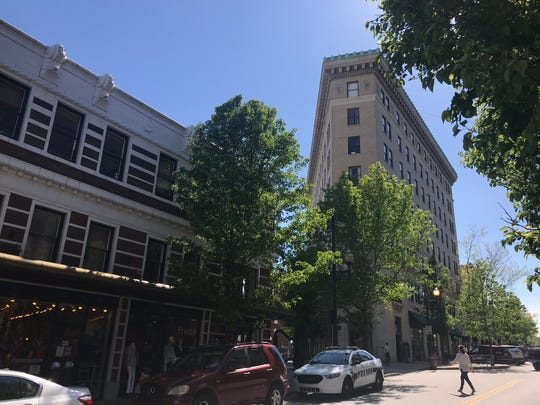 A proposal to redevelop downtown Asheville's historic Flatiron Building as a boutique hotel was delayed from the April 23 Asheville City Council meeting, where it had been expected to be heard.