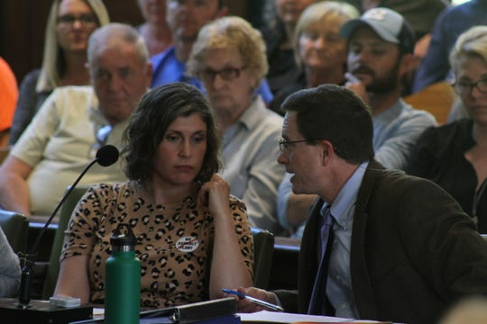 Attorney Brian Gulden, right, speaks with Emily Sonntag of the Sustainable Madison group opposed to the asphalt plant.