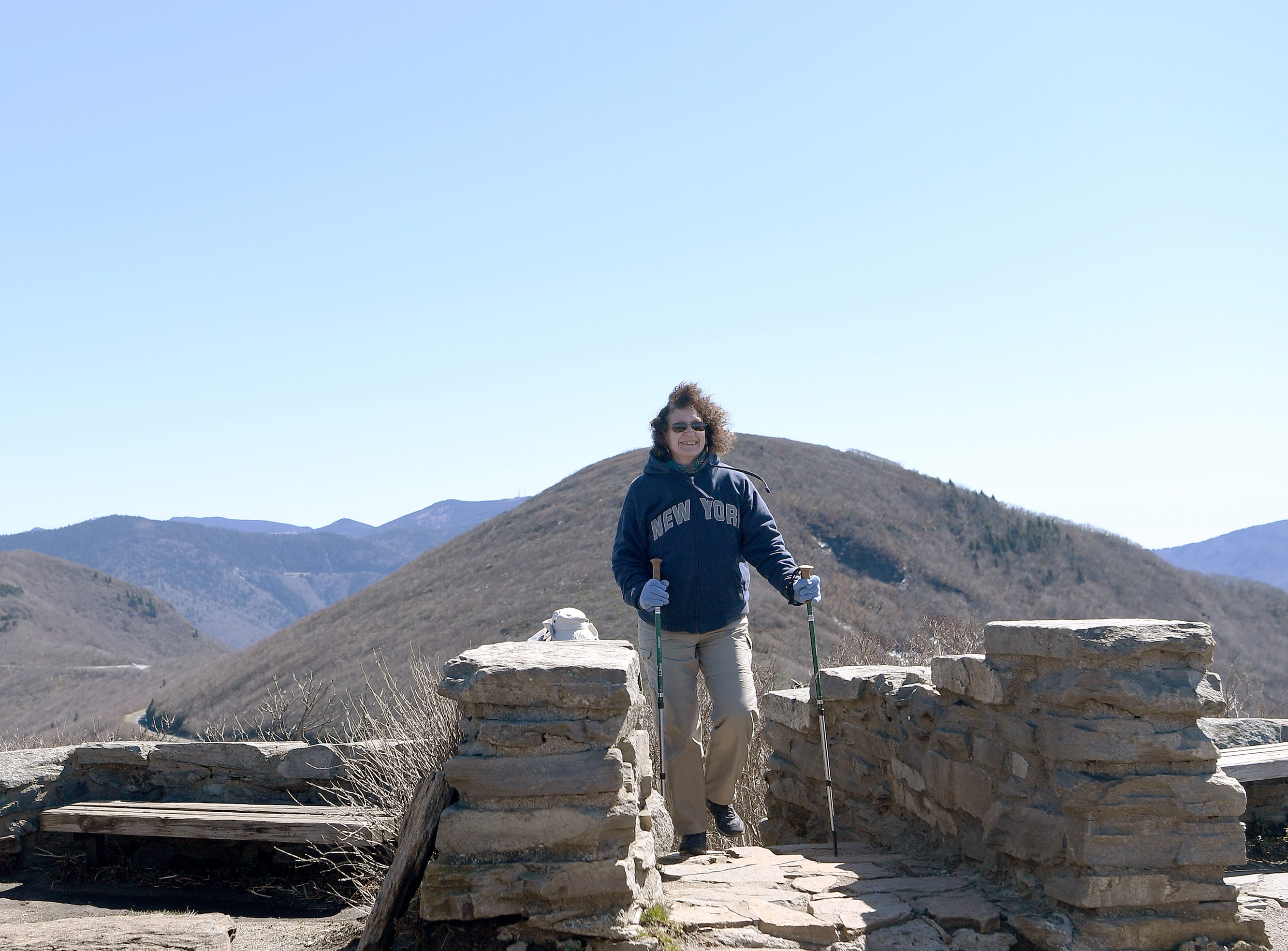 Claire Davis, of West Virginia, climbs the final stair to the top of the Craggy Pinnacle on the Blue Ridge Parkway on April 22, 2019.