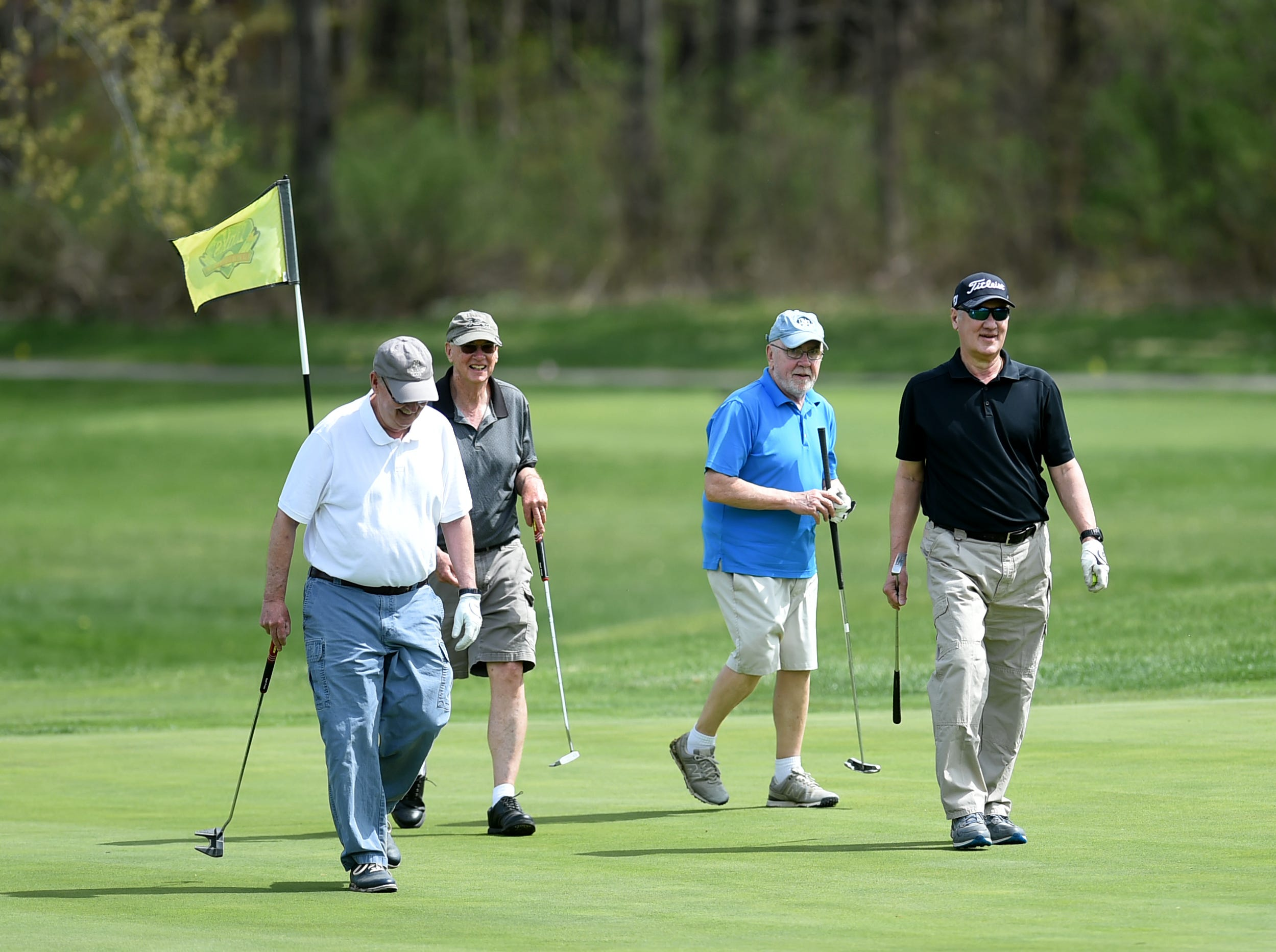 Golfers enjoy the warm weather at The Links at Hiawatha Landing in Apalachin on Tuesday, April 23, 2019.