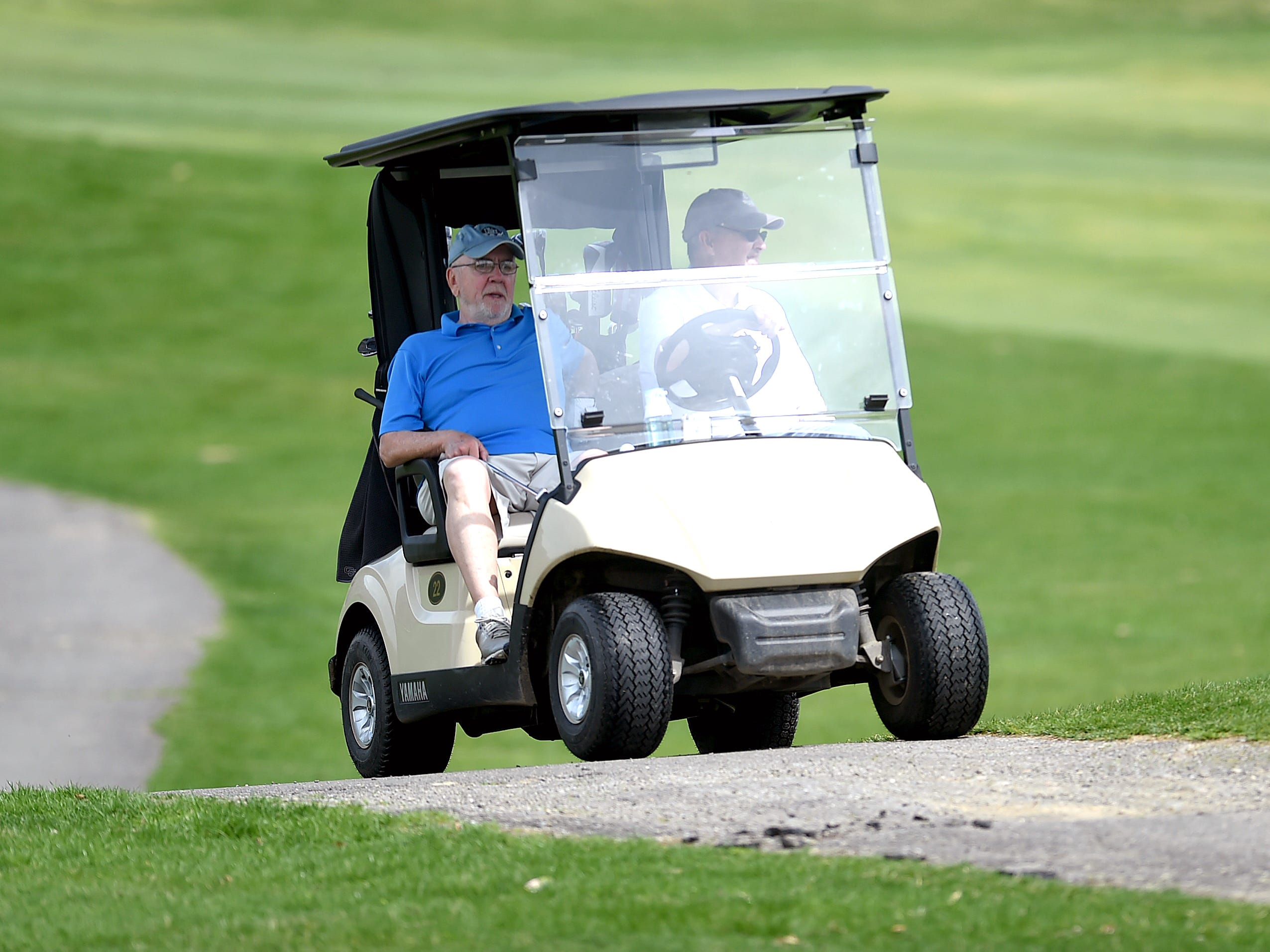 Ferdinand Haverly of Endicott rides in a golf cart at The Links at Hiawatha Landing in Apalachin on April 23, 2019.