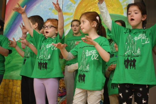 """St. James School first grader Ann Remore (center) performs in the Catholic Schools of Broome County's production of """"The Wizard of Oz"""" during a rehearsal on April 22."""