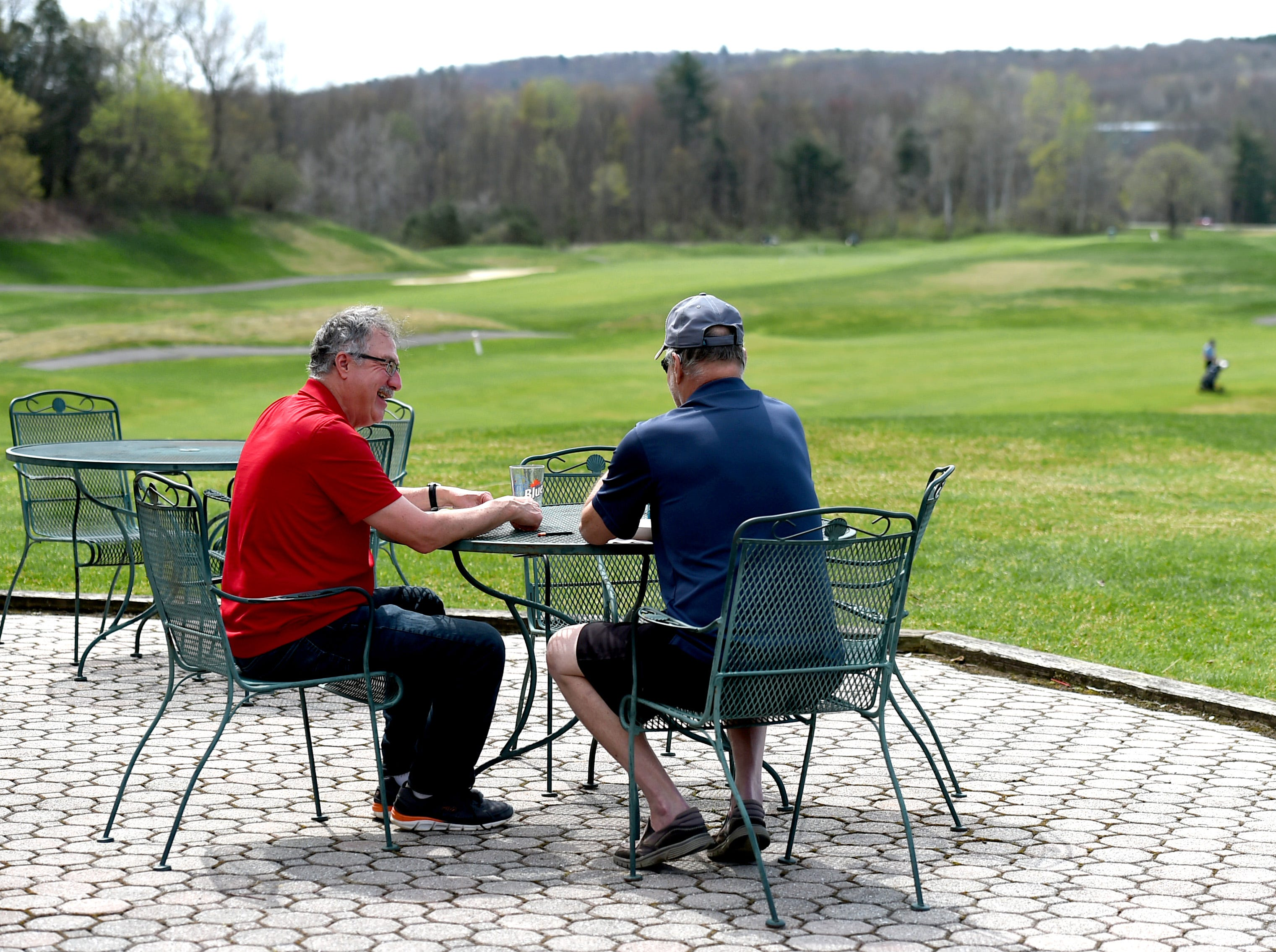 Rich Knight of Vestal, left, and Chris Wood of Newark Gallery, right, enjoy lunch after golfing at The Links at Hiawatha Landing on Tuesday, April 23, 2019.