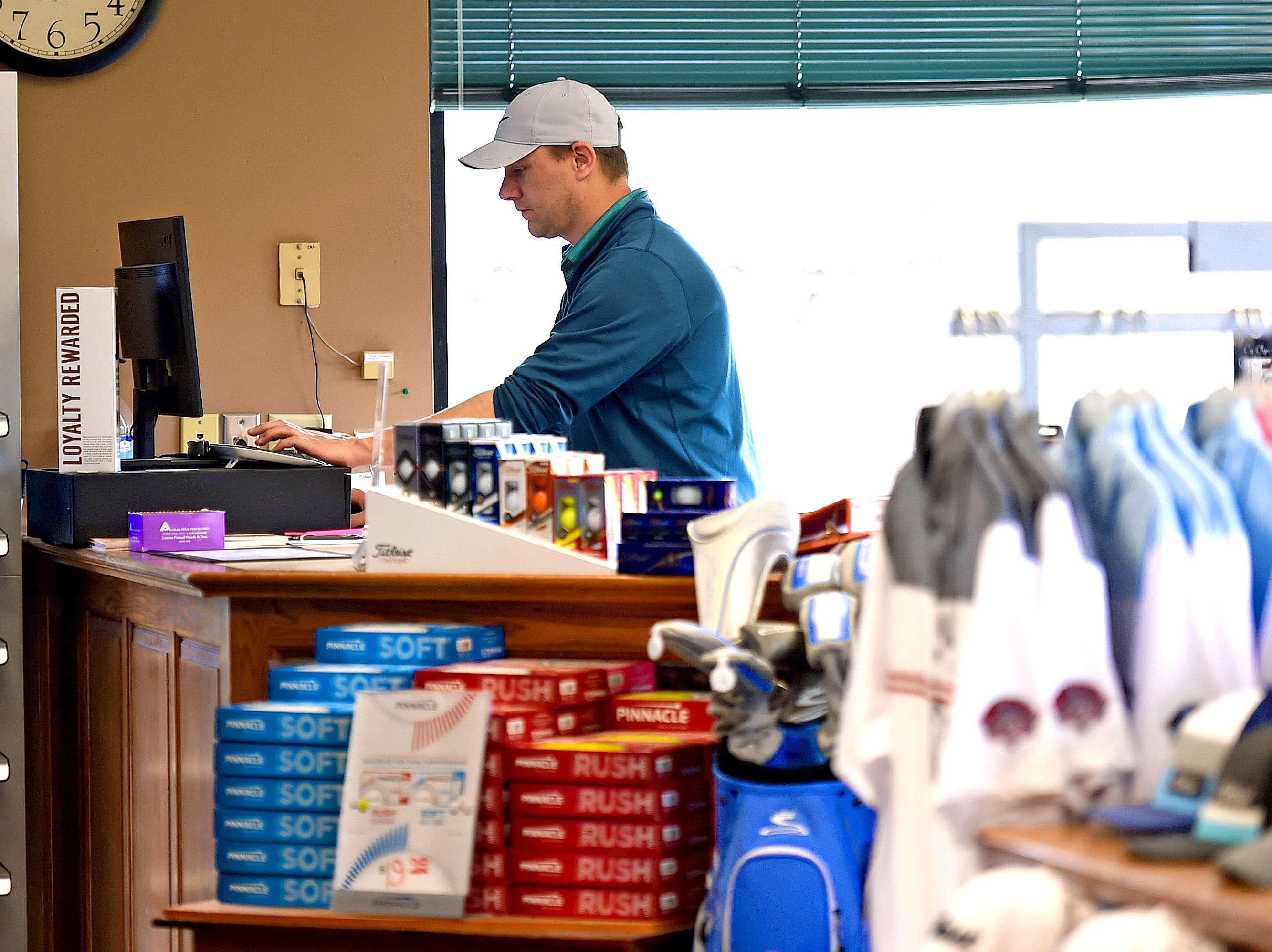 Jason Gozney of Binghamton works in the pro shop at The Links at Hiawatha Landing on Tuesday, April 23, 2019.
