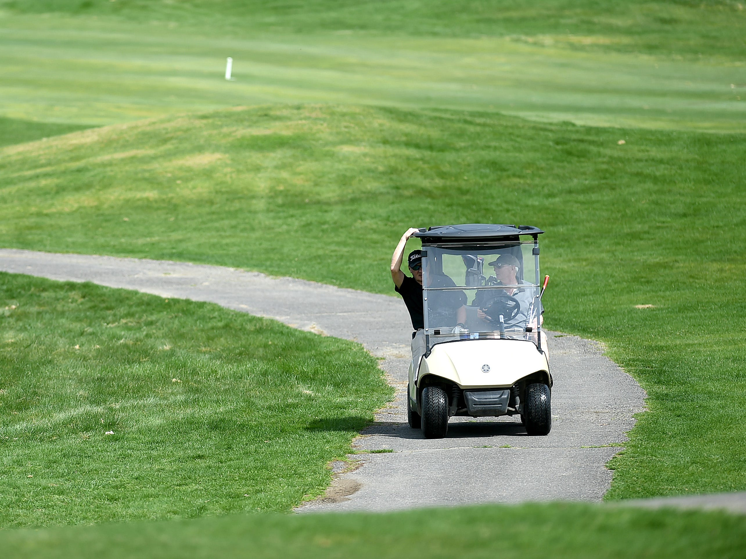 Golfers enjoy the spring weather at The Links at Hiawatha Landing in Apalachin on Tuesday, April 23, 2019.
