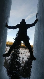 Shane Moskowitz, the former standout distance runner for Central Kitsap, practices ice climbing near his home in Durango, Colorado.