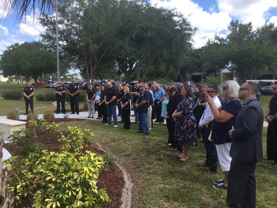 Mourners gather at Sacrifice Park on  Tuesday morning  to honor two fallen police officers who were killed in the line of duty 32 years ago.