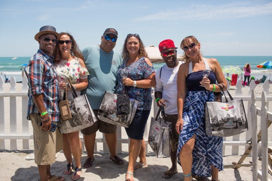Guests enjoy hanging out on the beach while sipping wine and sampling food at last year's Cocoa Beach Uncorked.
