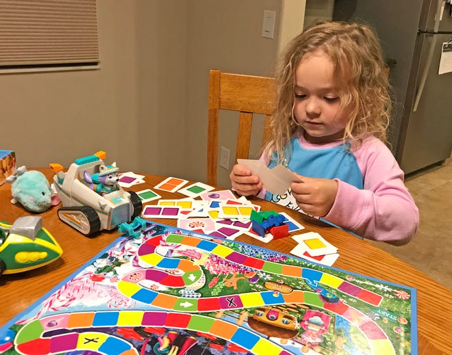 Isabella gets ready to play another game of Candy Land on a recent evening.
