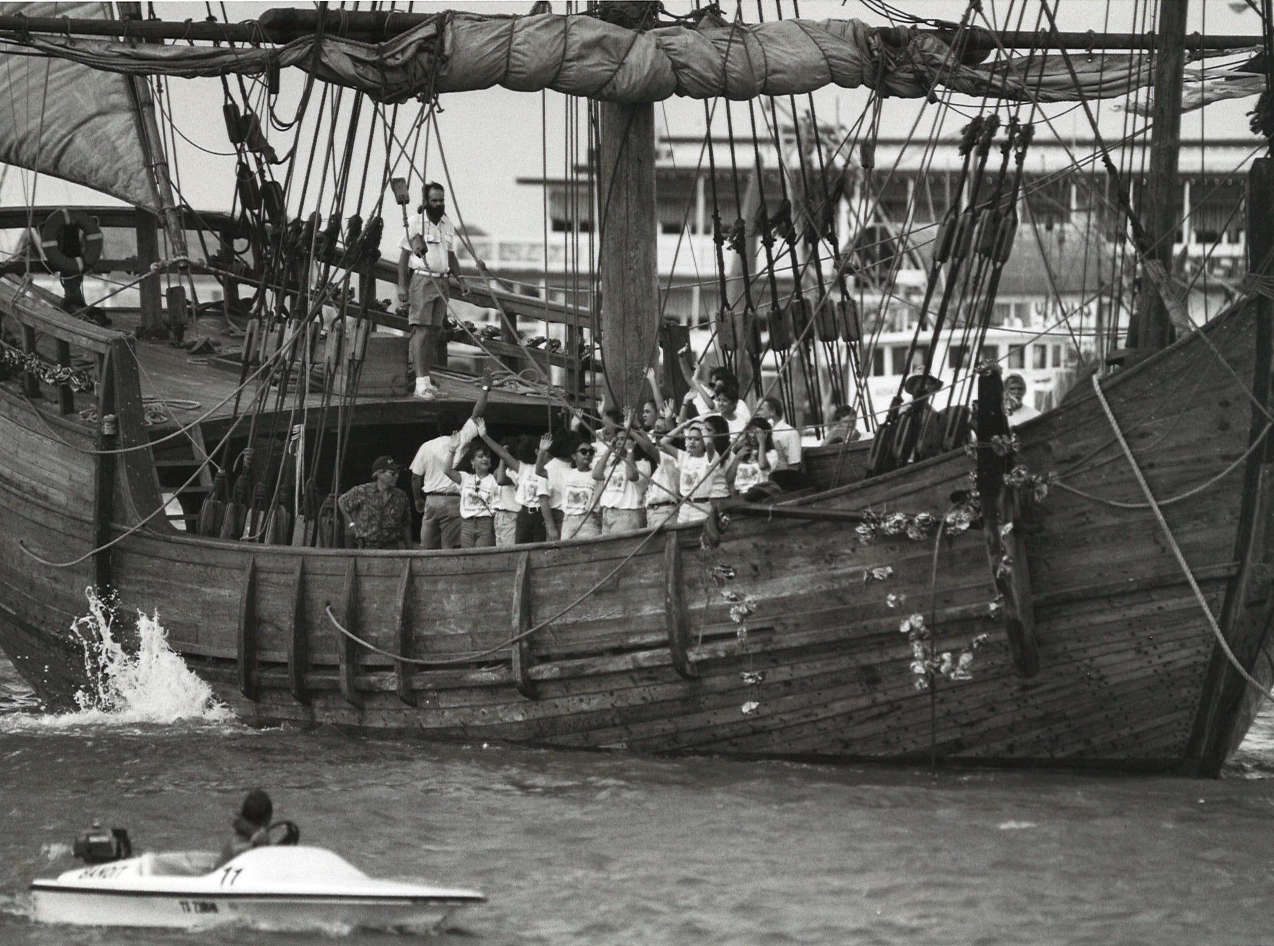 The crew of the Niña struggle to bring the ship carrying Feria de las Flores contestants into the marina between the Lawrence Street T-head and the Peoples Street T-head on Aug. 9, 1994. High winds made manuevering the ship difficult.