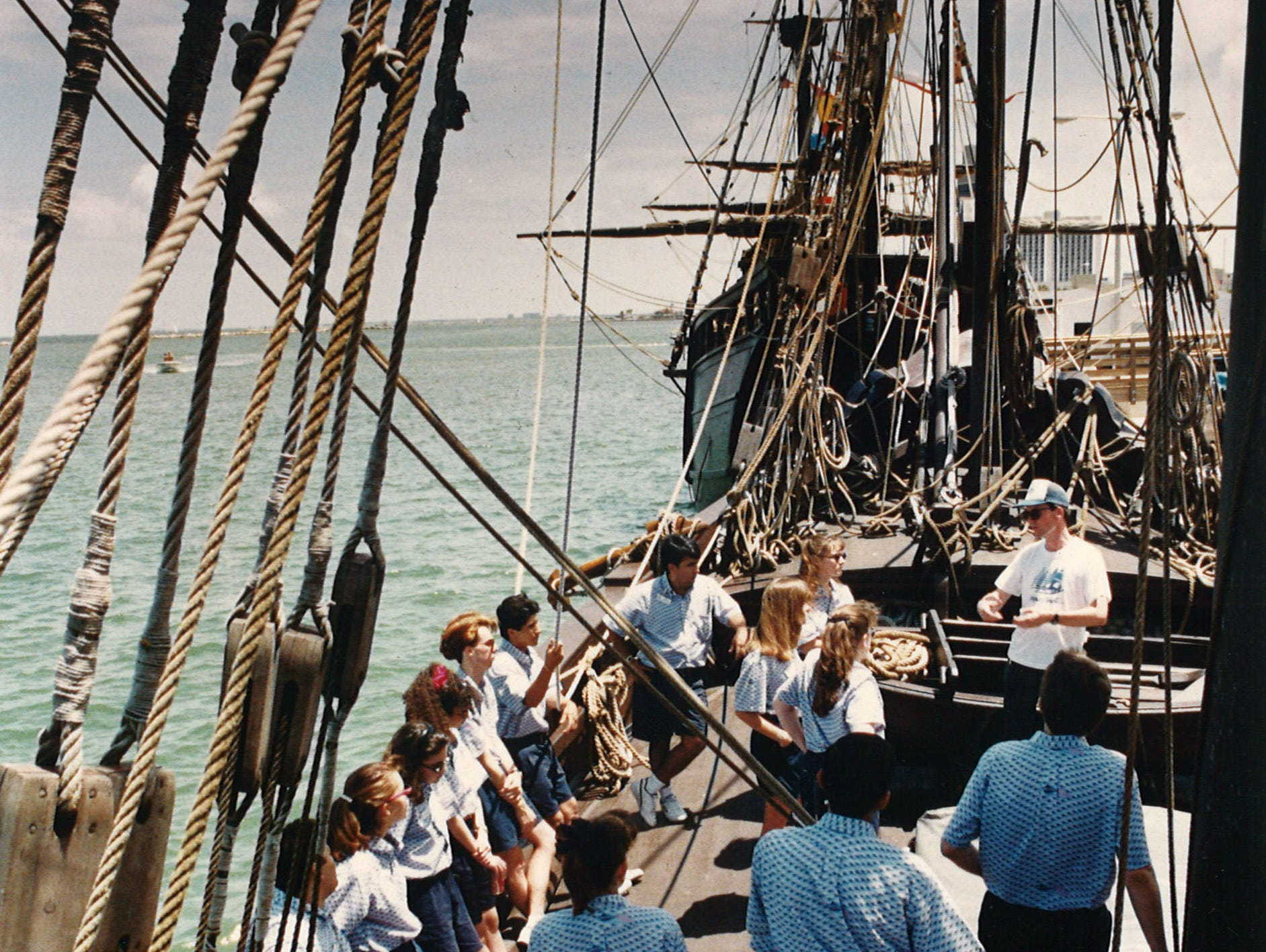 Rick Stryker (in hat), president of the Columbus Fleet Association, instructs future tour guides on proper protocol when aboard the Columbus ships. He lectured from the Niña on June 13, 1993.