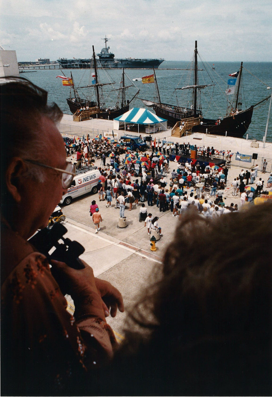 People watch from the second floor of the Bayfront Plaza Auditorium as a dedication ceremony is held at the Corpus Christi Barge Dock for the three Columbus ship replicas on June 12, 1993.