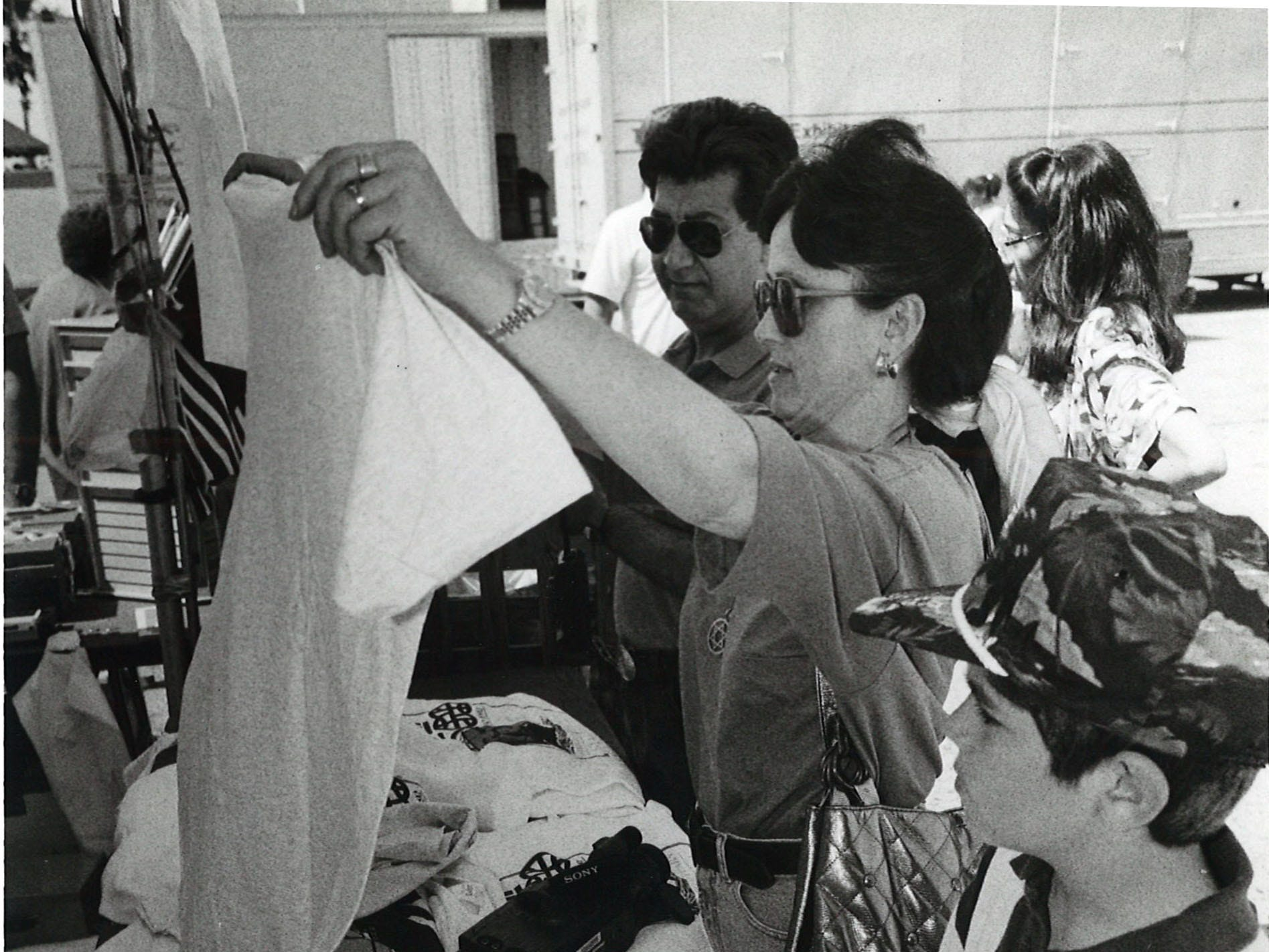 Benny Beniflah (left), Anna Beniflah and their son Jacob check out souvenirs at the site of the Los Barcos ships on March 17, 1992. The Columbs ships docked in Corpus Christi for 10 days as part of the 500th anniversary of Christopher Columbus' voyage to the Americas.