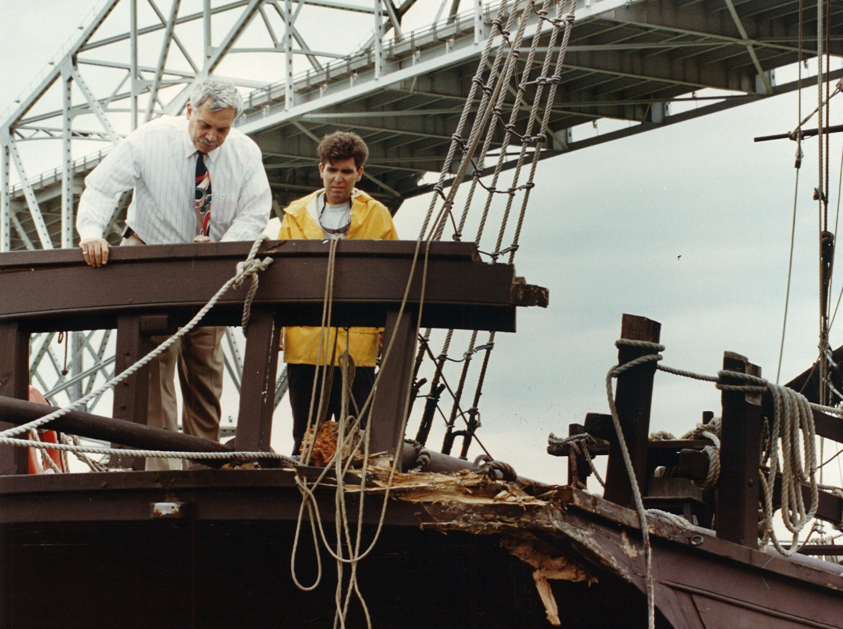 Port of Corpus Christi Authority industrial relations and military liasons officer Tony Alejandro (left) and ship's mate Jose Antonio Barrera (right), stand on the quarterdeck near the Pinta's stern on April 12, 1994. The Columbus ship replica was damaged when a port vessel ran into the ship, causing the Pinta to hit the Santa Maria.