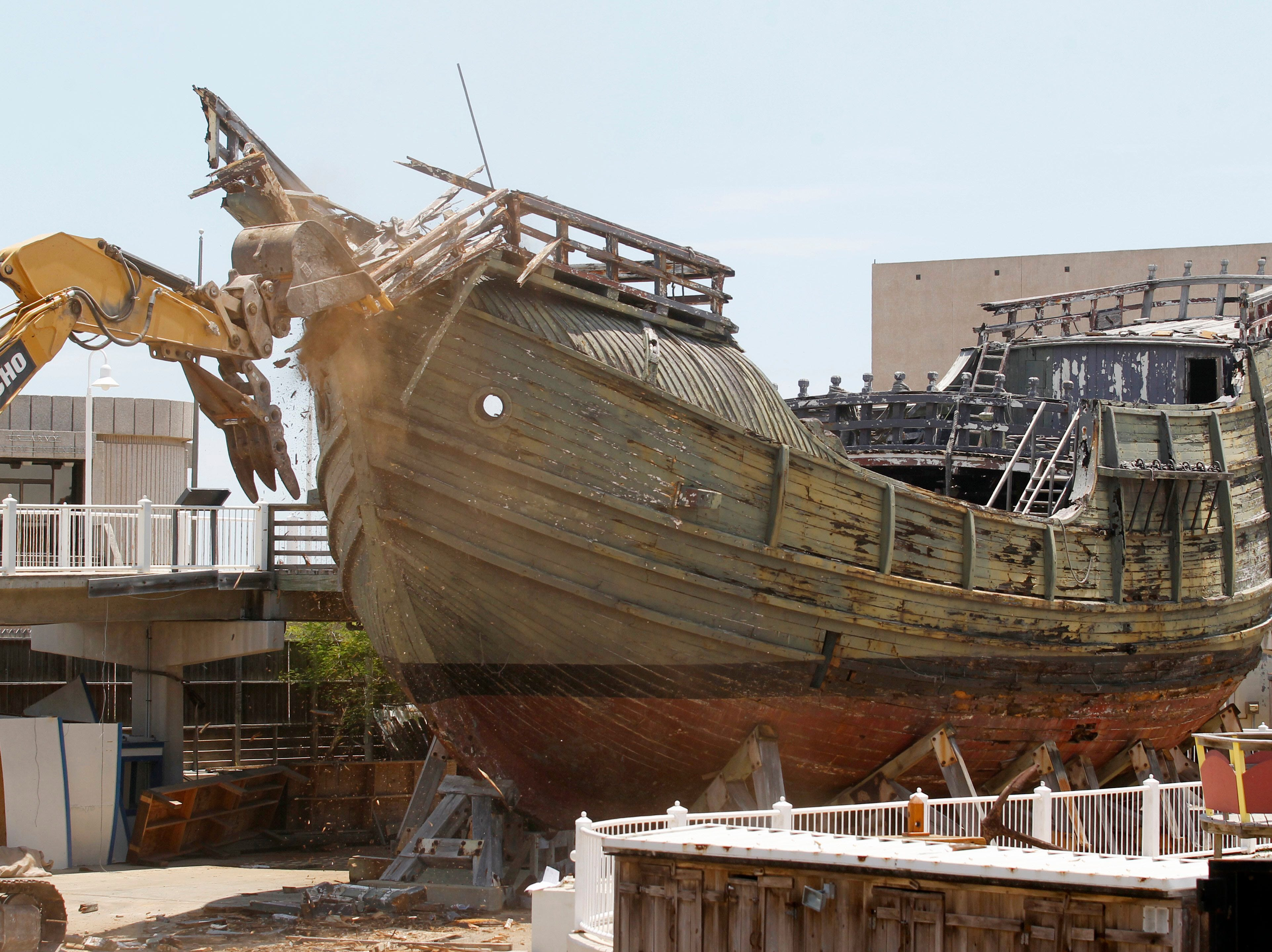 Crews rip into the front of the Santa Maria Tuesday, Aug. 12, 2013 as they take down the second of the two Columbus replica ships at the Corpus Christi Museum of Science and History.