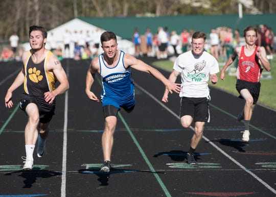 Southeastern junior Lane Ruby, second from left, dominated the 100-meter dash Monday afternoon with a time of 11.131 with Paint Valley junior Brayden Ison, left,  close behind with a time of 11.132. Ruby broke three records at the meet: 100-meter dash, 200-meter dash with a time of 22.64, and the long jump by 21-07.25. The Westfall girls and Chillicothe boys took first place at the annual Huntington High School Invitational track meet on April 23, 2019. Other local teams that participated were Huntington, Paint Valley, Adena, Southeastern, Piketon, and Zane Trace.