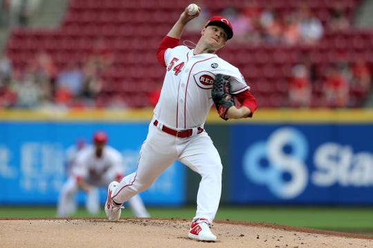 Cincinnati Reds starting pitcher Sonny Gray (54) delivers in the first inning of an MLB baseball game against the Atlanta Braves, Tuesday, April 23, 2019, at Great American Ball Park in Cincinnati.