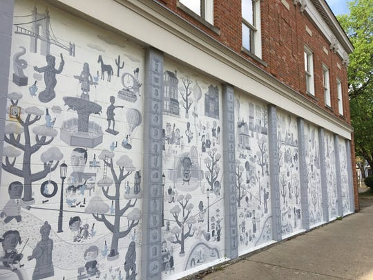 """April 23, 2019:  The ArtWorks mural """"An Epic of Time and Town"""" created in 2009 at the John R. Green building at 411 W. 6th St. will be demolished. The building will be the site of 177 new John R. Lofts apartments scheduled to open in spring 2021, according to developer RealtyLink LLC."""